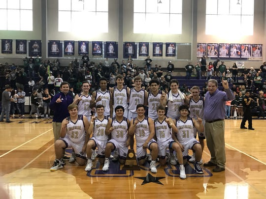 The San Saba High School boys basketball team poses with its Region IV-2A championship trophy Saturday, March 7, 2020, at the Snake Pit at San Marcos High School.