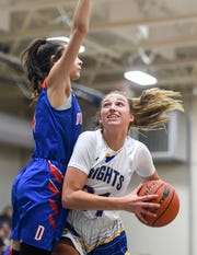 O'Gorman's Emma Ronsiek (31) goes up for a shot during the game against Douglas on Friday, March 6, 2020 at O'Gorman High School in Sioux Falls.