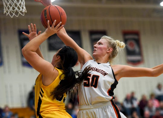 Washington's Sydni Schetnan (50) blocks a shot by Mitchell during the game on Friday, March 6, 2020 at Washington High School in Sioux Falls.