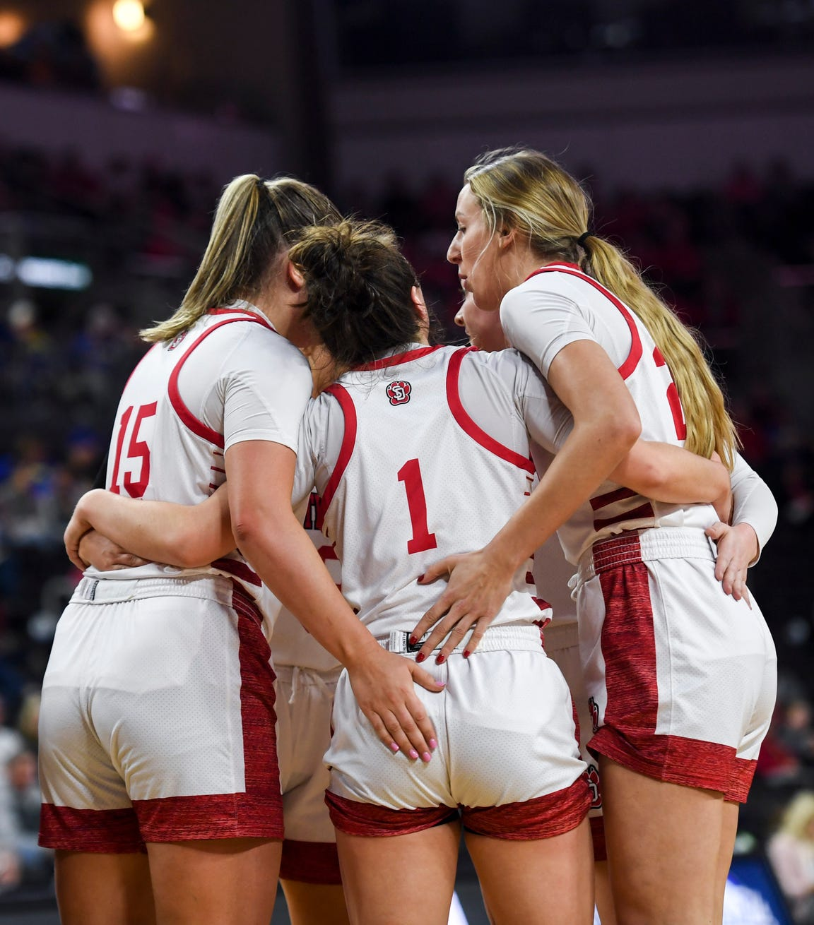 USD women huddle in between plays during the Summit League tournament game against Omaha on Saturday, March 7, 2020 at the Denny Sanford Premier Center.
