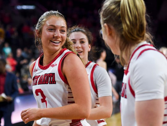 USD's Macy Guebert (3) heads to the locker room with her teammates after a win against Omaha during the Summit League tournament on Saturday, March 7, 2020 at the Denny Sanford Premier Center.