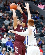 Missouri State's Gaige Prim (44) puts up a shot defended by Indiana State's Bronson Kessinger (5) at the Missouri Valley Conference Tournament, Friday, March 6, 2020, at the Enterprise Center in St. Louis.