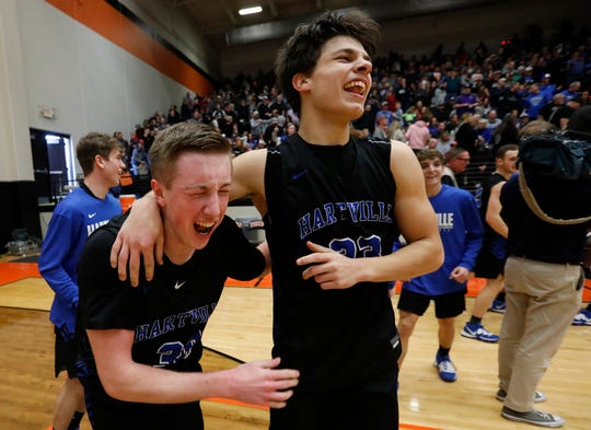 Brady Ward, left, and Cody Mahan, of Hartville, celebrate after the Eagles' 49-47 win in their quarterfinal game against Greenwood at Republic High School on Saturday, March 7, 2020.