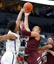 Missouri State's Gaige Prim (44) puts up a shot against Indiana State at the Missouri Valley Conference Tournament, Friday, March 6, 2020, at the Enterprise Center in St. Louis.