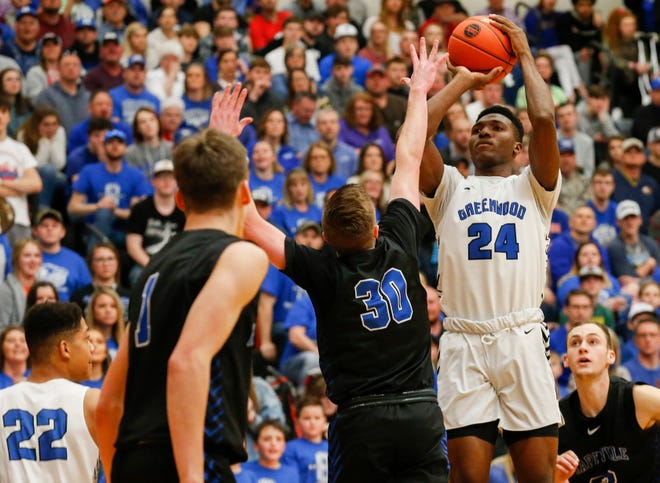 Aminu Mohammed, of Greenwood, puts up the shot during the Blue Jays' quarterfinal game against Hartville at Republic High School on Saturday, March 7, 2020.