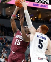 Missouri State's Lamont West (15) puts up a shot defended by Indiana State's Bronson Kessinger (5) at the Missouri Valley Conference Tournament, Friday, March 6, 2020, at the Enterprise Center in St. Louis.