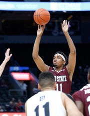Missouri State's Isiaih Mosley (11) puts up a shot against Indiana State at the Missouri Valley Conference Tournament, Friday, March 6, 2020, at the Enterprise Center in St. Louis.