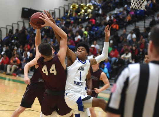 John Marshall's Dana Woodley tries to block a shot by 	Stuarts Draft's Blake Stinespring Friday night. John Marshall beat Stuarts Draft in the Class 2 state quarterfinals at Huguenot High School in Richmond.