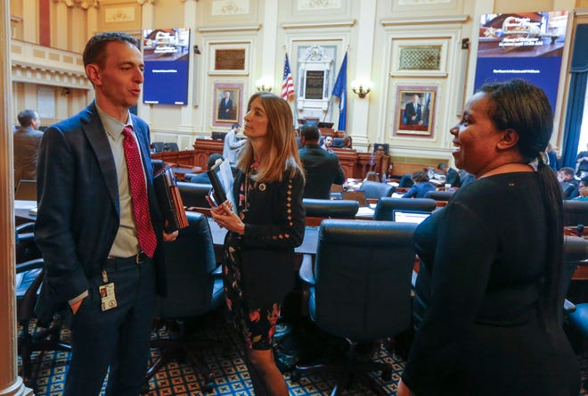 House Speaker Del. Eileen Filler-Corn, D-Fairfax, center talks with Del. Marcus Simon, D-Fairfax, left, and House majority leader Del. Charniele Herring, D-Alexandria, right, during a break in the session at the Capitol Friday March 6 , 2020, in Richmond, Va.