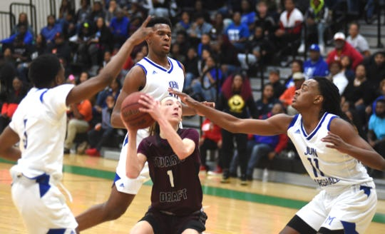 Stuarts Draft's Ryan Riley tries to get up a shot in the land of the giants Friday night. John Marshall beat Stuarts Draft in the Class 2 state quarterfinals at Huguenot High School in Richmond.