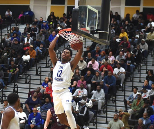 John Marshall's Roosevelt Wheeler dunks during Friday night's game. John Marshall beat Stuarts Draft in the Class 2 state quarterfinals at Huguenot High School in Richmond.