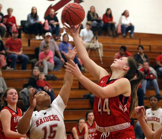 The Gladiators' Berkeley Tyree outstretches Rappahannock's Demeriah Holmes for this rebound.