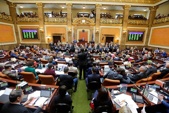 FILE - In this Jan. 27, 2020, file photo, he floor of the Utah House of Representatives is viewed during the Utah legislative session in Salt Lake City. Abortion clinics would be required to cremate fetal remains and women would have to get an ultrasound before the procedure under proposals that passed the Utah House this week, over objections that the new rules would erode access to abortion. (AP Photo/Rick Bowmer, File)