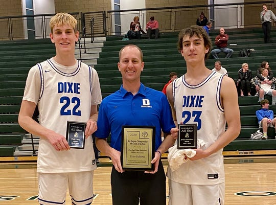Dixie coach Tyler Roberts poses with his 4A Coach of the Year award, along side Noah Lemke and Jordan Mathews who were UHSBCA All-Stars.