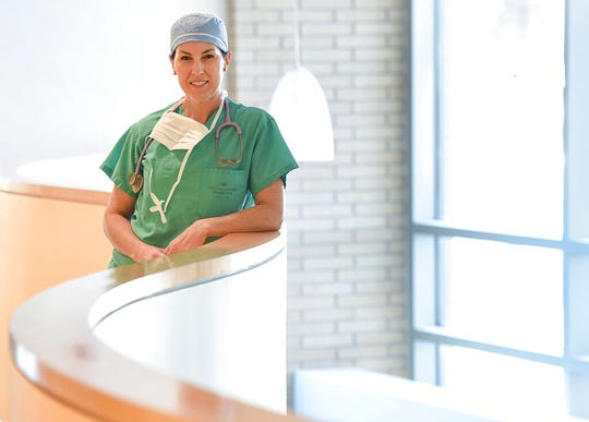 """FILE - In this Dec. 19, 2018, file photo, then-Rep.-elect Suzanne Harrison, steps out of her role as an anesthesiologist at Riverton Hospital in Riverton, Utah. Abortion clinics would be required to cremate fetal remains and women would have to get an ultrasound before the procedure under proposals that passed the Utah House this week, over objections that the new rules would erode access to abortion. It passed the Utah House on Thursday over the objections of Democrats like Harrison, who said it would force doctors to """"perform completely unnecessary tests, which, actually in this case, can potentially increase harm to the fetus."""" It now moves to the Senate. (Francisco Kjolseth/The Salt Lake Tribune via AP, File)"""