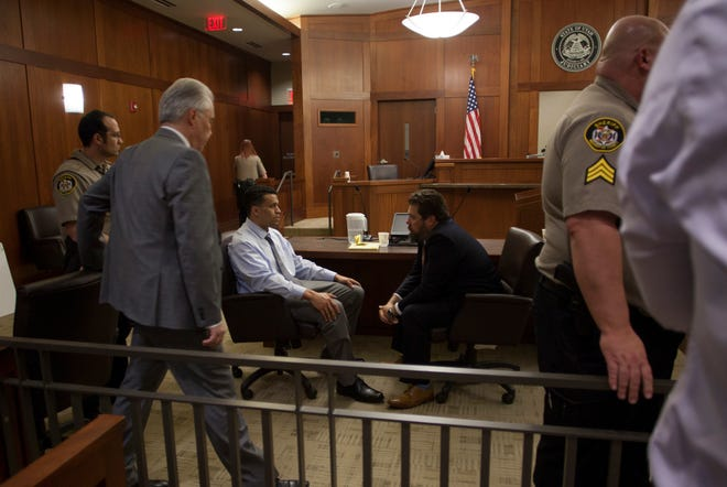 Bronson Flynn speaks with his defense attorney Trevor Terry after the jury delivered their guilty verdict Friday, March 6, 2020.