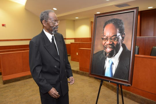 Retired Florida A&M University General Counsel Bishop Holifield admires portrait unveiled in his honor on March 6, 2020 at the FAMU College of Law in Orlando.