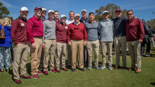 Legendary golfer Jack Nicklaus poses with members of the FSU men's golf team at the grand opening of the Seminole Legacy Course Saturday morning.