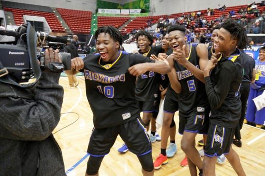 Rickards players celebrate their Class 5A state title Saturday.