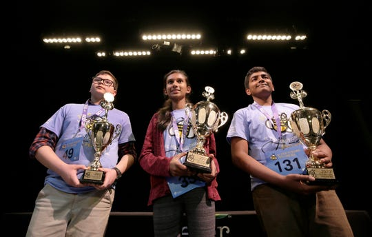 The top three spellers at the El Paso Regional Spelling Bee are, center, first place Sheneli De Silva, in second place Joshua Jones, right, and in third place was Isai Sanchez.