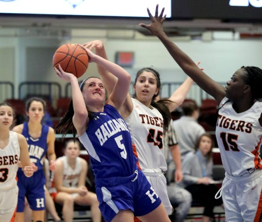 Haldane's Olivia Monetleone tries to get off a shot as Tuckahoe's Olivia Mondrone and Brianna Bodjolle defend during game action from the Haldane vs. Tuckahoe Section One Class C Girls Championship at the Westchester County Center in White Plains, March 7, 2020.