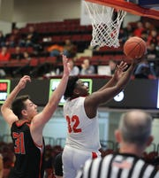 Hamilton's Jourdan Belcher goes up for a shot in front of Tuckahoe's Jonathan Berger during game action between Alexander Hamilton and Tuckahoe during the Section One Class C Boys Championship game at the Westchester County Center in White Plains, March 7, 2020.