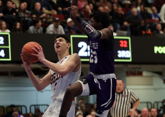 Horace Greeley's Chris Melis (3) drives to the basket in front of New Rochelle's Jaheim Gregory (23) during the boys Class AA semifinal at the Westchester County Center in White Plains March 6, 2020. Greeley won the game 71-56.