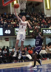 Horace Greeley's Sean Dunleavy (1) drives to the basket in front of New Rochelle's Jaheim Gregory (23) during the boys Class AA semifinal at the Westchester County Center in White Plains March 6, 2020. Greeley won the game 71-56.