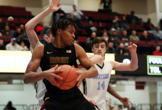 Mt. Vernon's Troy Hupstead (30) drives to the basket against Suffern during the boys Class AA semifinal at the Westchester County Center in White Plains March 6, 2020. Mt. Vernon won 56-50 in overtime.