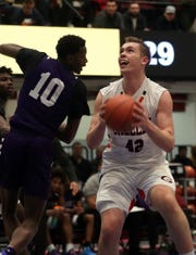 Horace Greeley's Nick Townsend (42) drives to the basket in front of New Rochelle's Amani Parkes (10) during the boys Class AA semifinal at the Westchester County Center in White Plains March 6, 2020. Greeley won the game 71-56.