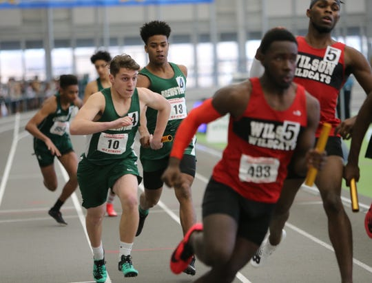 Brewster's Michael Gonch takes the baton from Jason Whitehead in the 4x200-meter relay during the NYSPHSAA Indoor Track & Field Championships at the Ocean Breeze Athletic Complex in Staten Island on Saturday, March 7, 2020.