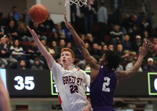 Horace Greeley's Will LaFortezza (22) drives to the basket in front of New Rochelle's Christian Rogers (2) during the boys Class AA semifinal at the Westchester County Center in White Plains March 6, 2020. Greeley won the game 71-56.