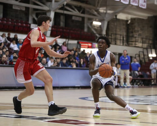 Salesian's Camar Neil (14) puts up a shot during their 57-51 win over Regis in the CHSAA intersectional Class Bboys basketball championship game at Fordham University's Rose Hill Gymnasium in the Bronx on Friday, March 6, 2020.