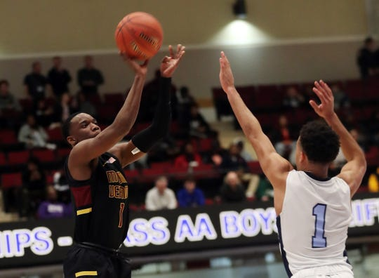 Mt. Vernon's Irvin Patrick (1) puts up a shot in front of Suffern's Jo'el Emanuel (1) during the boys Class AA semifinal at the Westchester County Center in White Plains March 6, 2020.