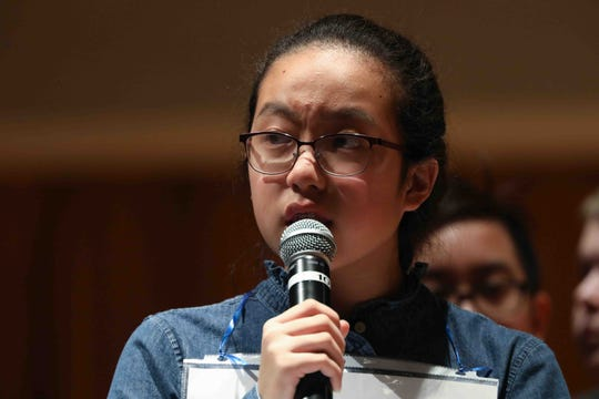 Ha-An Nguyen of Smyrna Middle School competes in the 30th annual State Spelling Bee competition Saturday March. 07, 2020, at Anna Graham Theater on the campus Saint Marks High school in Newark, DE. She won the competition. Sage Sawhney of F. Niel Postlethwait Middle School took second place and Anaum Allimulla of Newark Charter School Intermediate placed third.