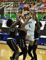 Rider's Kellar Owens goes up between three Mansfield Timberview defenders during a Region I-5A semifinals game at The Coliseum in Snyder On Friday, March 6, 2020.