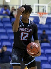Hirschi's Jahiem Quarles signals to his teammates in the game against Pampa Friday, March 6, 2020, in the Region I-4A boys basketball tournament at Lubbock Christian University.
