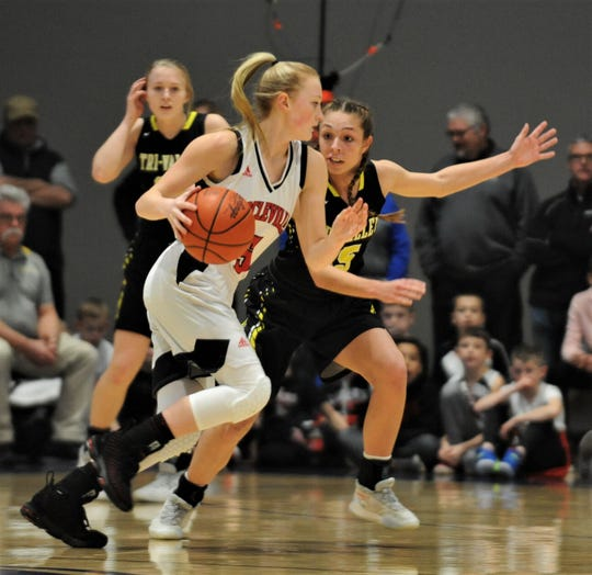 Tri-Valley's Lauren King defends Circleville's Tori Bircher in Friday's Division II regional final at Zanesville's Winland Memorial Gymnasium. The Scotties won 45-43 in overtime to reach the final four.