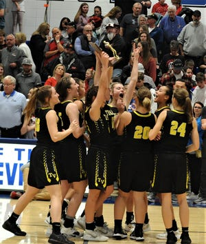 The Tri-Valley girls basketball team celebrates a 45-43 overtime win over Circleville in Friday's Division II regional final at Zanesville's Winland Memorial Gymnasium. The Scotties earned a berth in the state final four.