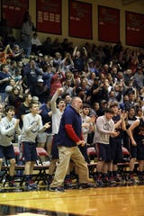 The Morgan bench, including head coach  Rob Justice react after a score against Ridgewood.