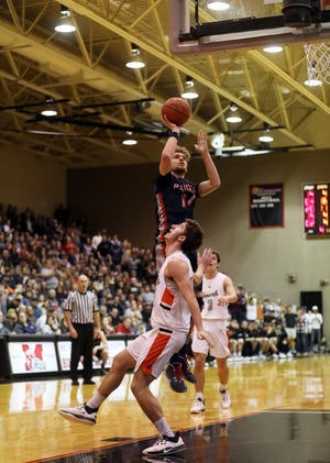 Morgan's Carver Myers puts up a shot against Ridgewood in last year's district finals. Myers is one of several seniors back for the Raiders, who look to challenge league newcomer Meadowbrook for the MVL Small School Division title.