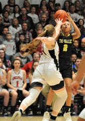 Tri-Valley's Lexi Howe puts up a shot over Circleville's Kenzie McConnell in Friday's Division II regional final at Zanesville's Winland Memorial Gymnasium. The Scotties won 45-43 in overtime to reach the final four.