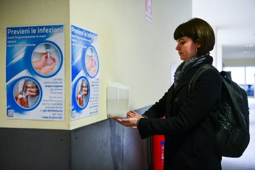 A student at the University Milano Bicocca uses a hand sanitizer in Milan, on March 5, 2020.