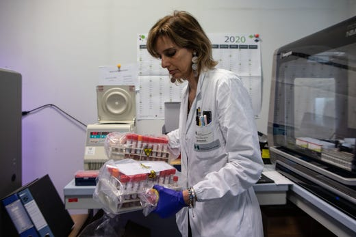 Dr. Chiara Vismara handles vials during a swab test process in the Molecular biology laboratory of the Ospedale Niguarda, on March 5, 2020 in Milan, Italy.