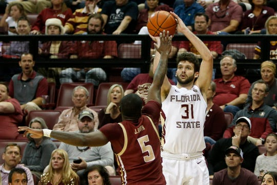 Florida State Seminoles forward Wyatt Wilkes shoots over Boston College Eagles guard Jay Heath during the first half.