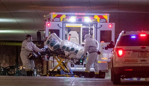 A woman who tested positive with the coronavirus is brought to the University of Nebraska Medical Center, March 6, 2020. She was transferred from Omaha's Methodist Hospital in an isolation pod inside an ambulance.