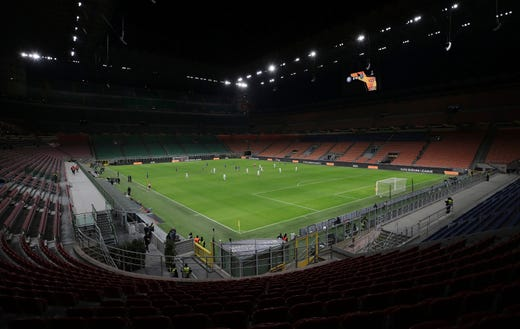 The seats are empty as a precaution against the coronavirus at the San Siro stadium in Milan, Italy, during the Europa League round of 32 second leg soccer match between Inter Milan and Ludogorets on Feb. 27, 2020.