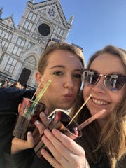 Sarah Lynch, right, with friend Julia Feigus outside Santa Croce church in Florence, Italy