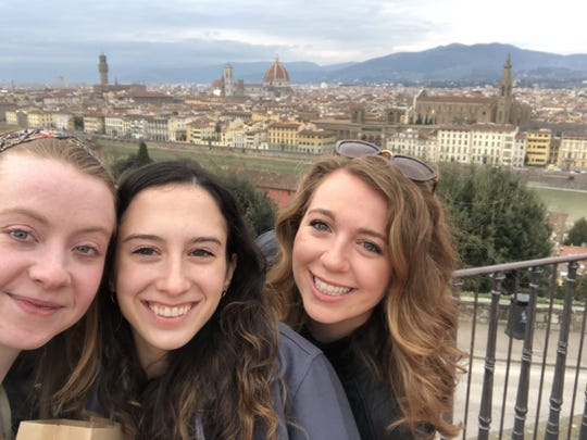 From left: Sarah Lynch of Interlaken, New Jersey, with friends Natalie Manzi and Julia Feigus, on Lynch's last day in Italy before being evacuated home due to the coronavirus outbreak. Florence is in the background.
