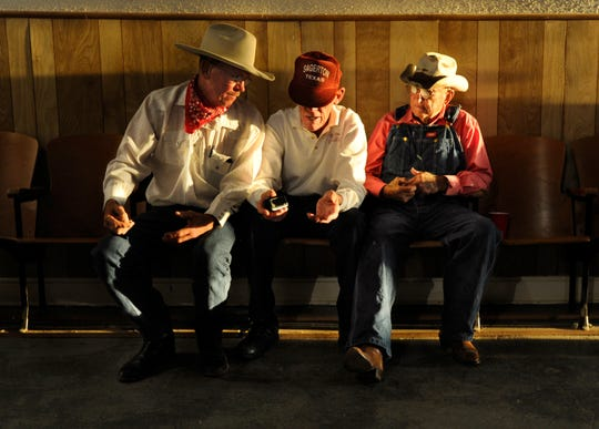 Clayton Stegemeoller, (left) speaks with his father Leon, and Delbert LeFevre prior to Thursday's Sagerton Hee Haw show in 2012. The homegrown variety show is modeled after the classic television show of the same name.